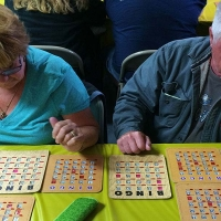man and woman playing bingo