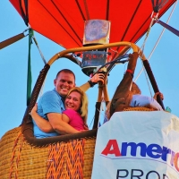 a couple in a hot air balloon