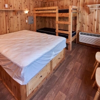 Cabin with double bed and bunk beds