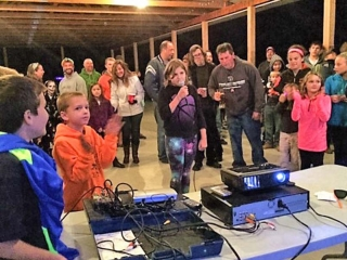 children and adults participating in karaoke