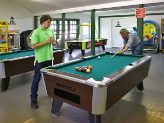two men playing billiards