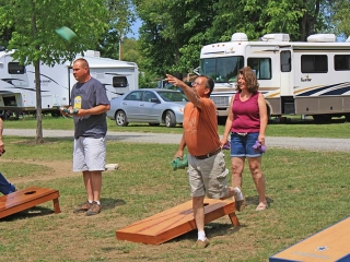 man and woman playing corn hole