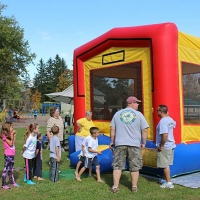children playing in bouncy house