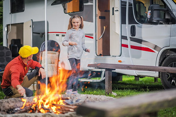 father and daughter outside of their rv camper