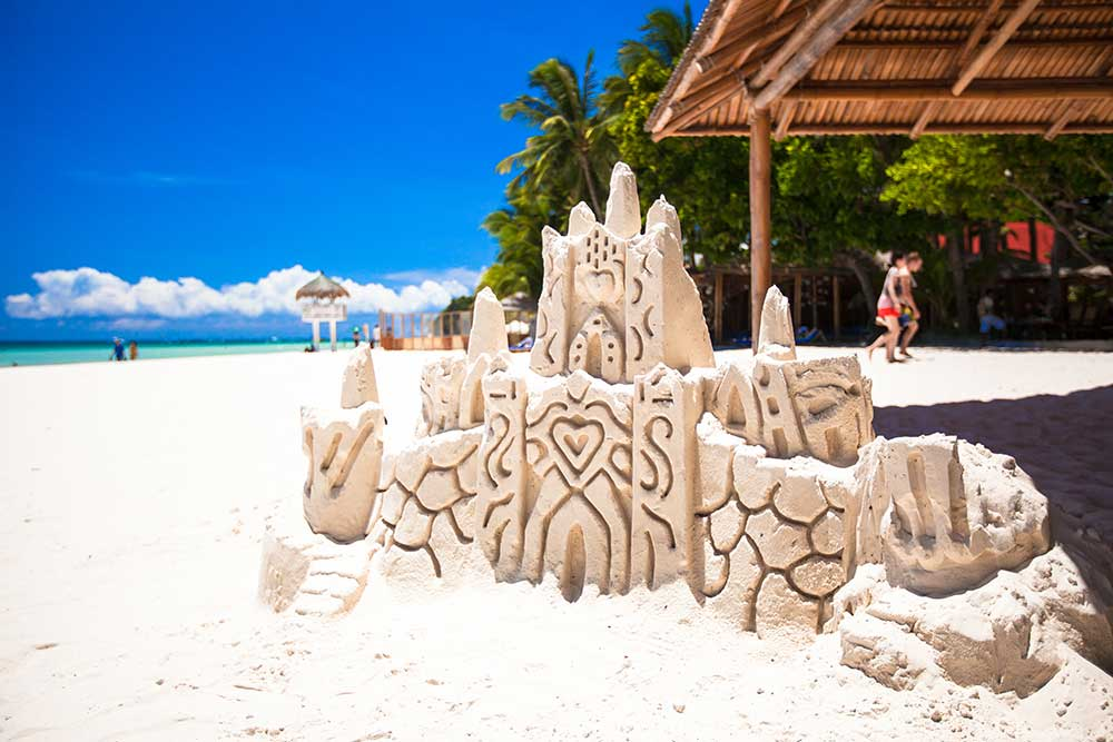 sand-castle-on-white-tropical-sandy-beach